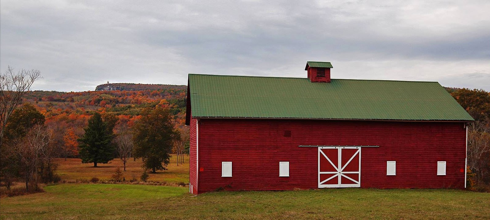 An old red barn overlooks Mohonk
