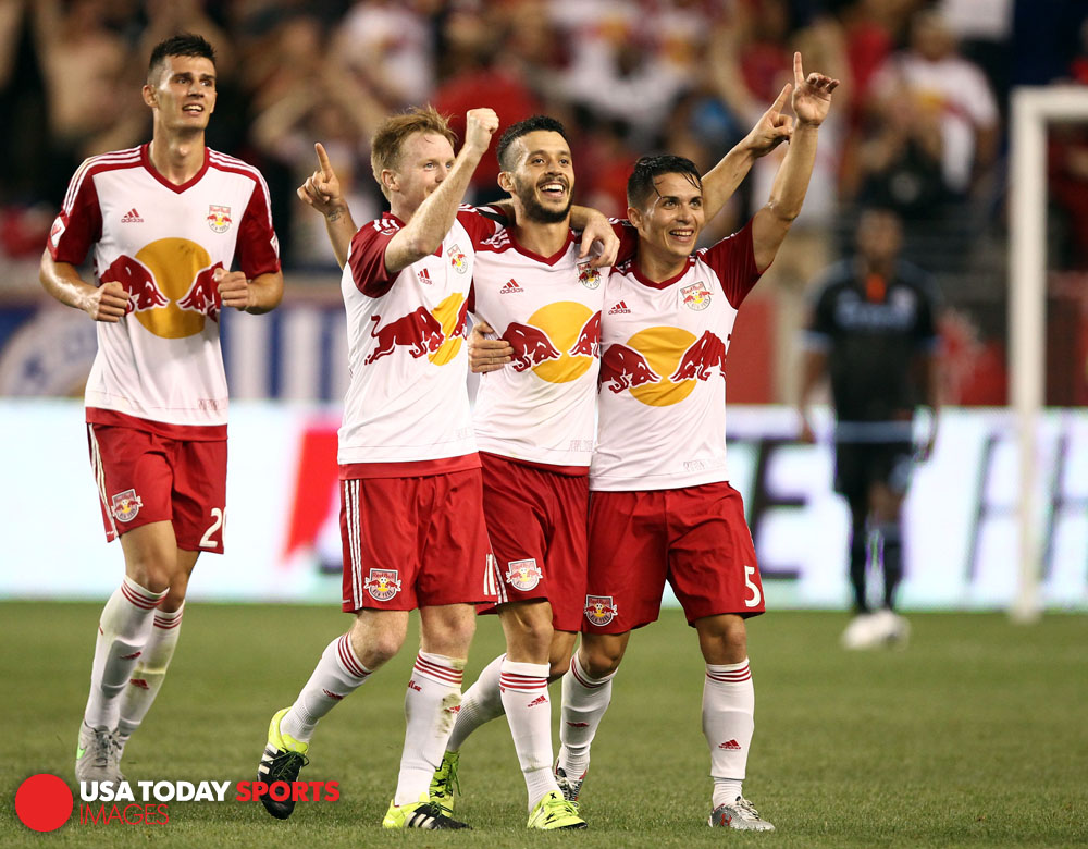 Aug 9, 2015; Harrison, NJ, USA; New York Red Bulls midfielder Felipe Martins (8) celebrates his goal with defender Connor Lade (5) and midfielder Dax McCarty (11) against New York City FC during the second half at Red Bull Arena. Mandatory Credit: Danny Wild-USA TODAY Sports
