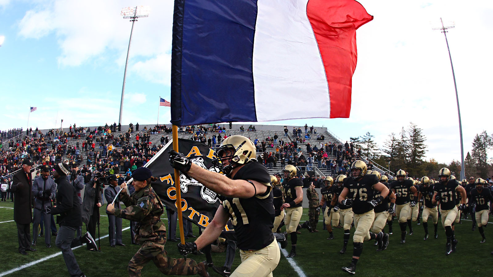 The Army football team carried a French flag a day after horrific terror attacks hit Paris