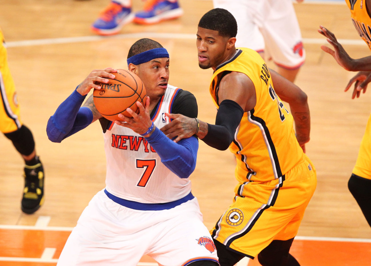 May 5, 2013; New York, NY, USA; New York Knicks forward Carmelo Anthony (7) drives against Indiana Pacers forward Paul George (24) at Madison Square Garden. Mandatory Credit: Danny Wild-USA TODAY Sports